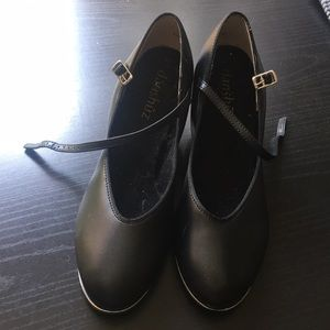 Black tap shoes with a little heel